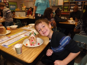 So proud of his gingerbread house!